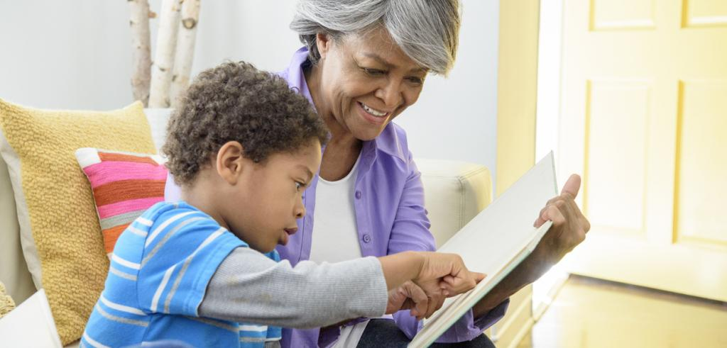 African American grandmother reading with grandson