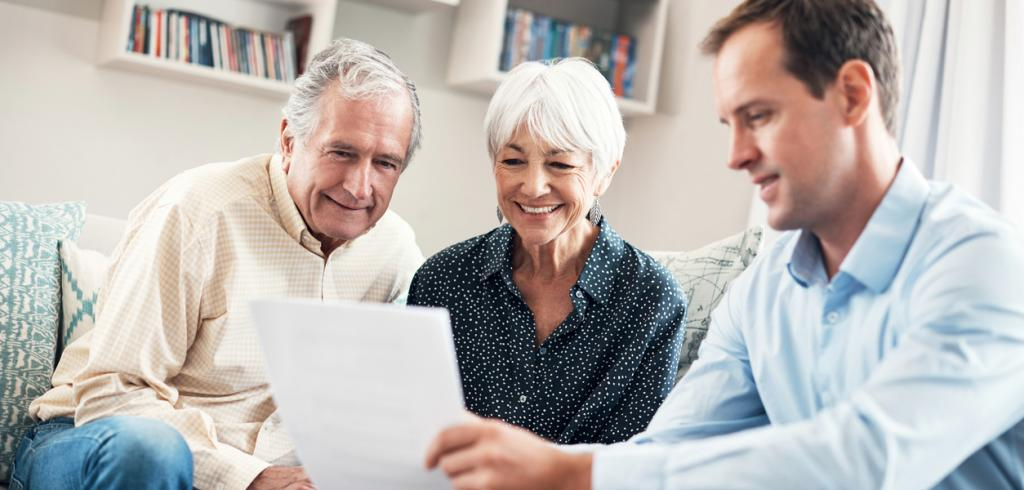 Financial advisor reviewing financial plan with elderly couple