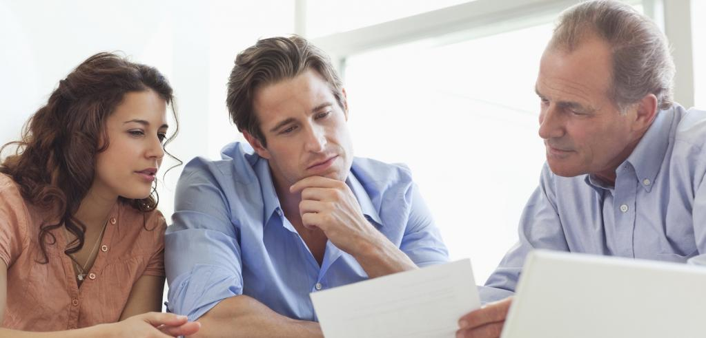 Financial Advisor reviewing retirement plan with clients