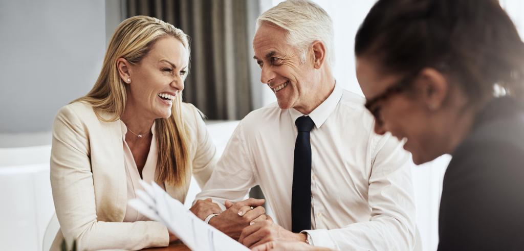 Happy couple meeting financial advisor