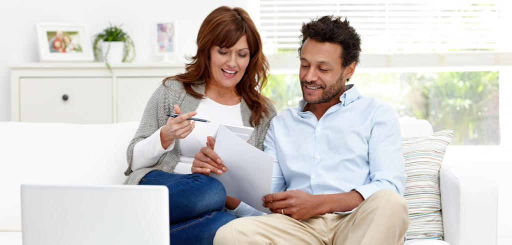 Mixed couple reviewing paperwork