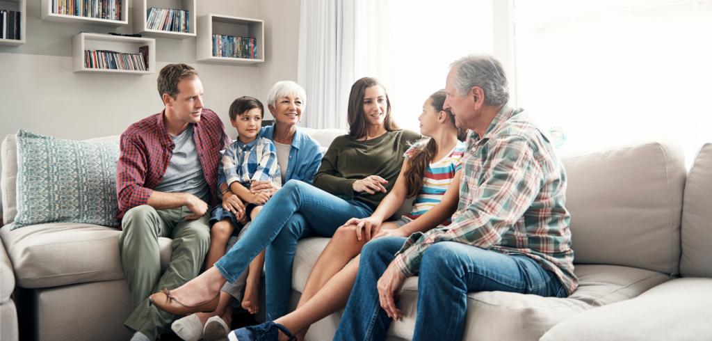 Multi generational family sitting on couch
