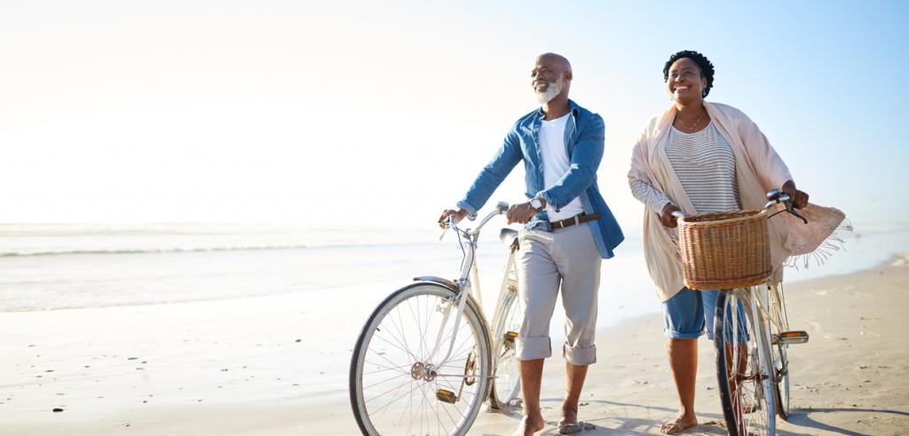 Retired couple walking along a beach