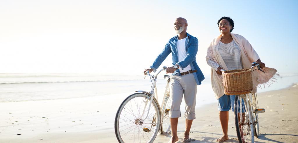 Retired couple walking along a beach