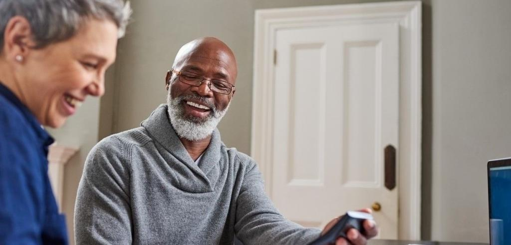 Retired couple reviewing financial statements and wealth plan