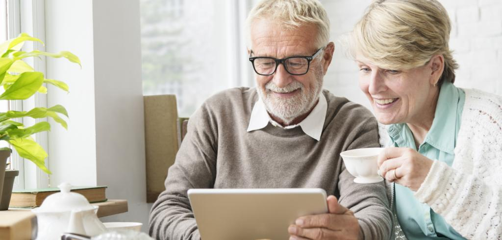 Senior adults using tablet