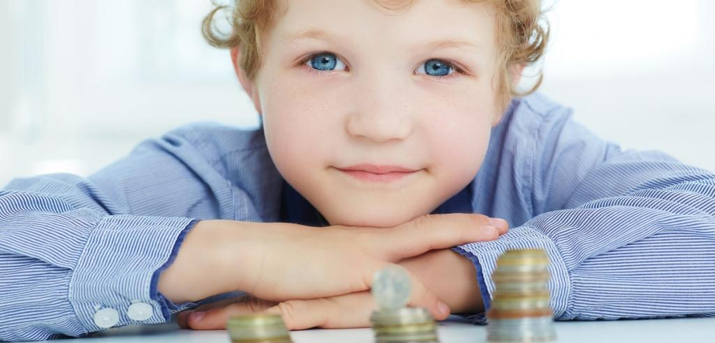 Young boy looking at money