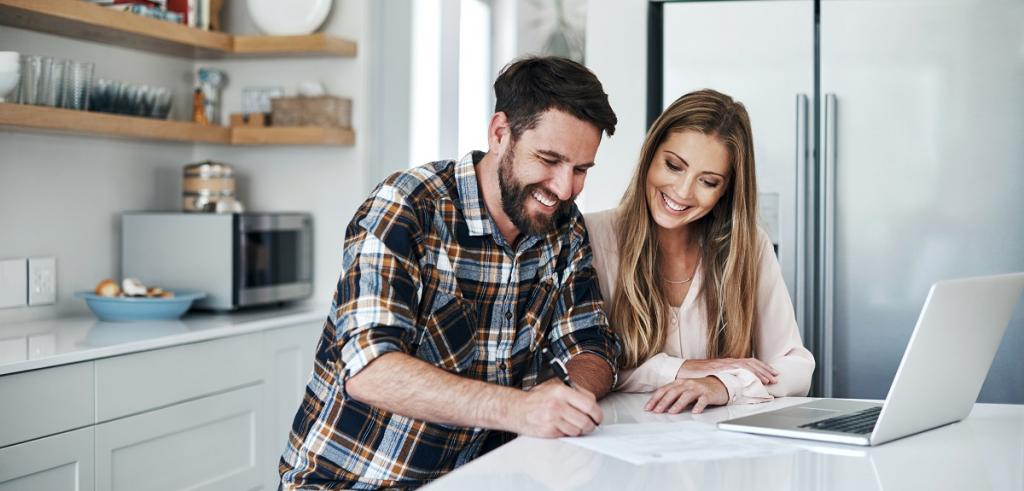 Young couple reviewing documents