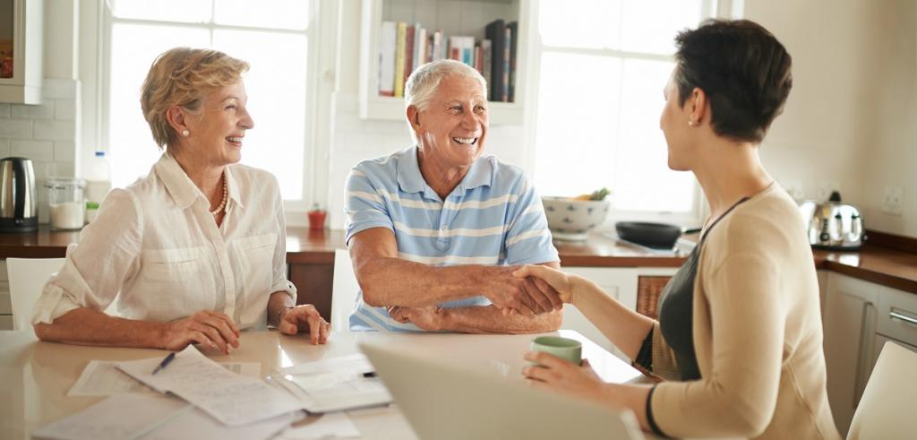 Retired couple meeting with financial advisor